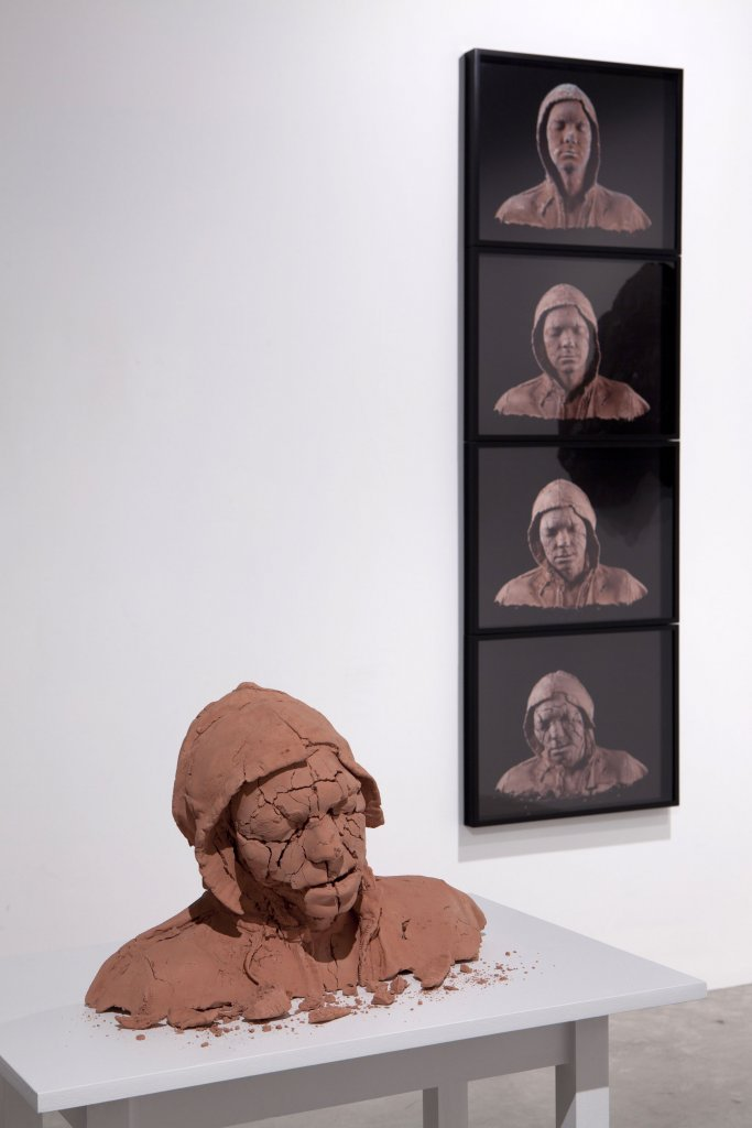 <p>[foreground] Tim Silver, <em>Untitled (bust) (Mahogany Timbermate Woodfiller)</em>, 2011, mahogany Timbermate woodfiller, 44 x 33 x 20 cm, original life casting: Keith Rae. [hanging] Tim Silver, <em>Untitled (bust) (Mahogany Timbermate Woodfiller)</em>, 2011,archival inks on archival paper, 4 framed prints, 46 x 58 cm each</p>