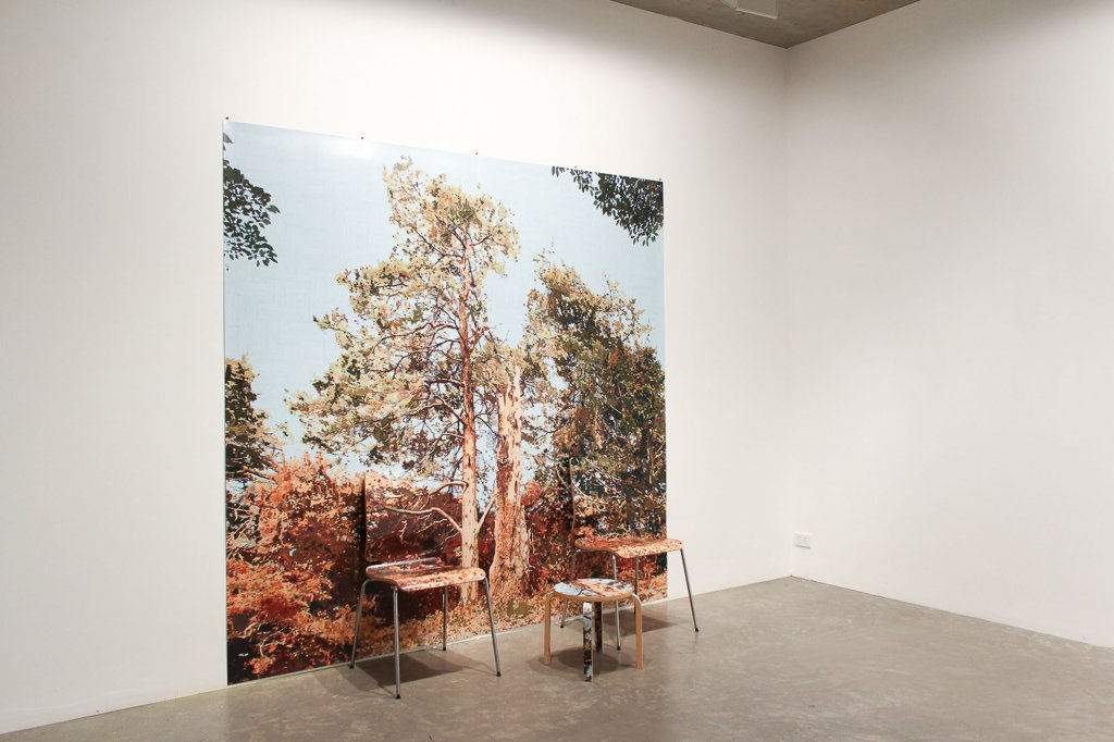 <p>Gary Carsley, <em>D.100/b Wave Hill (Tree Struck by Lightning)</em>,  2012,   Lambda monoprint, IKEA Gilbert chairs and Frosta stool,   235 x 245 x 85 cm </p>