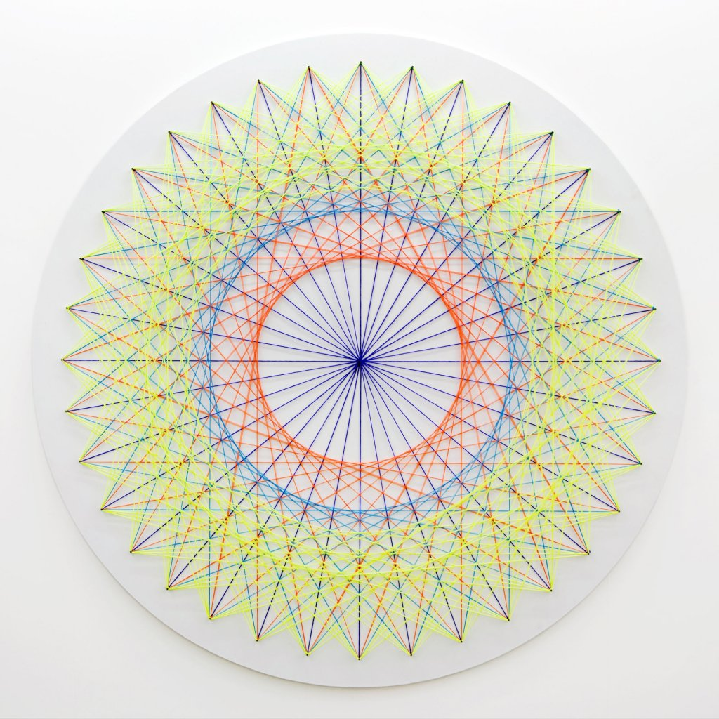 Nike Savvas <em>Sliding Ladder: Mandala</em> 2010 wood and wool 220 cm diameter